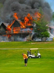 Guy Golfing with hour on fire in background