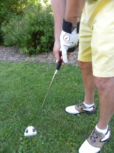 Putt with a locked wrist for a square impact and straight follow through.