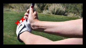 To ensure that you are swinging with a flat wrist, check for 2 knuckles at address and in the backswing.