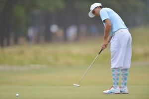 Firm putts through the hole with confidence would have put Rickie neck and neck with Martin