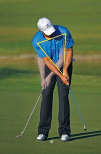 Golf Digest used this image of Tiger Woods to show that he putts with his shoulders and spine.  His wrists are locked.
