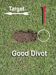 Take a straight divot just beyond your ball position.