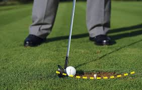 Your iron shots bottom out after you impact with the ball ( as your weight shifts forward).